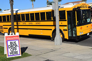 A school bus arriving at A Noise Within for a Student Matinee.