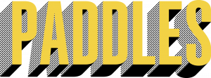 The word Paddles in tall gold font that three-dimensionally pops out with dotted black shading.